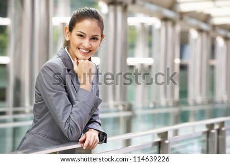Portrait Of Hispanic Businesswoman Outside Office - stock photo