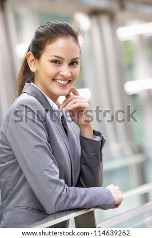 Portrait Of Hispanic Businesswoman Outside Office