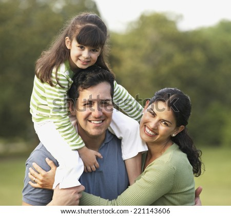 Portrait of Hispanic family - stock photo