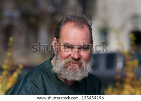 Portrait of homeless man outdoors during daytime - stock photo