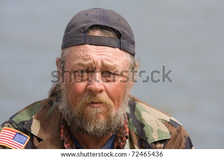 Portrait of homeless man with beard - stock photo