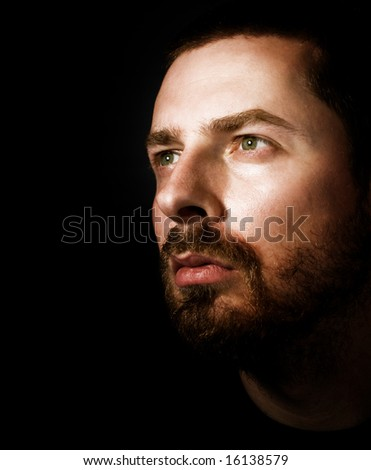 Portrait of hopeful man looking into the light - stock photo