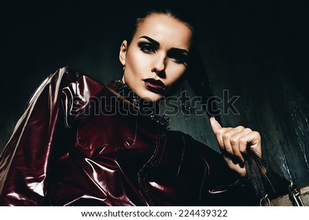 portrait of hot woman in claret glossy shirt