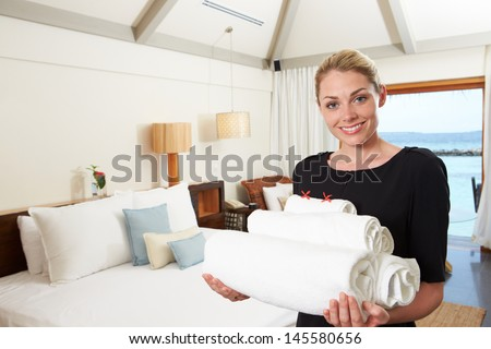 Portrait Of Hotel Chambermaid With Towels - stock photo