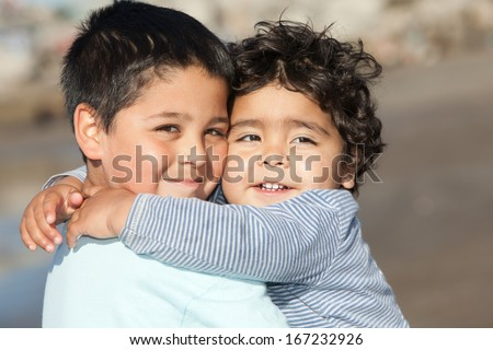 portrait of hugging little brothers - stock photo