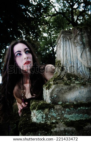 Portrait of hungry vampire on cemetery - stock photo