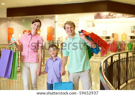Portrait of husband and wife with their son in trade center - stock photo