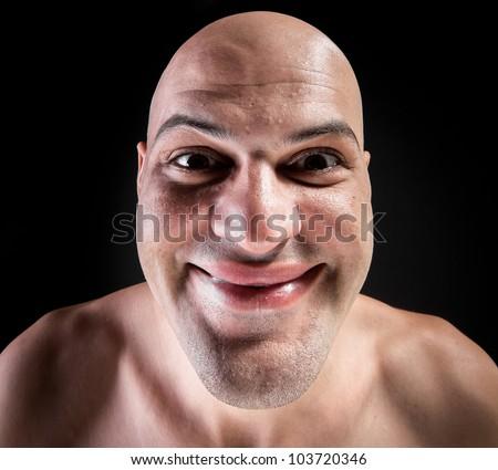 Portrait of idiotic andcrazy bald man - stock photo