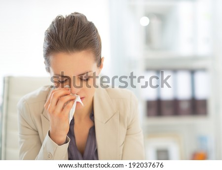 Portrait of ill business woman at work - stock photo
