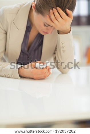 Portrait of ill business woman in office - stock photo
