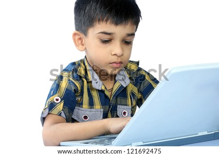 Portrait of Indian Boy using a laptop