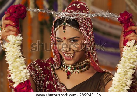 Portrait of Indian bride holding a garland