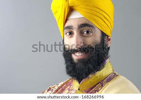 Portrait of Indian sikh man with bushy beard - stock photo