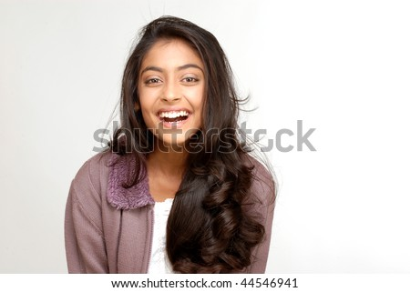 portrait of indian teenager smiling girl over white background - stock photo