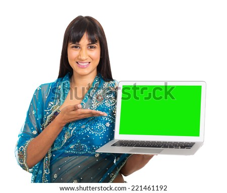 portrait of indian woman presenting green laptop screen on white background - stock photo