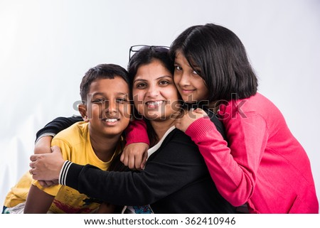 Portrait of indian young lady with teenagers, family photo of young indians, asian family and group photo, indian brother and sisters, asian young family
