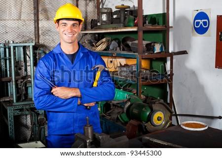 portrait of industrial repairman in workshop - stock photo
