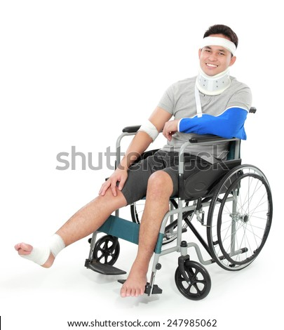 portrait of injured young man in wheelchair - stock photo