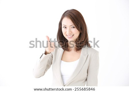 portrait of japanese business woman going thumb up - stock photo