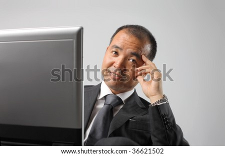 portrait of japanese manager working with laptop - stock photo