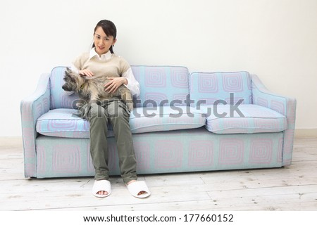 Portrait of Japanese woman hugging the dog