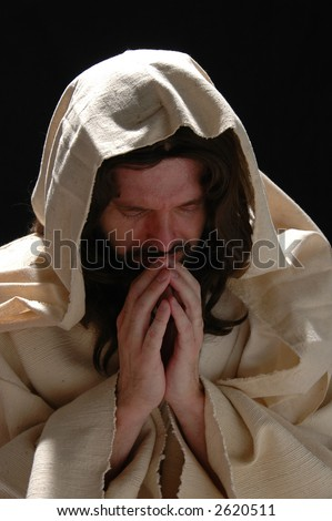 Portrait of Jesus in prayer with dark background - stock photo