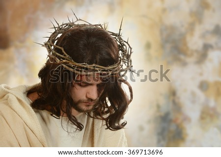 Portrait of Jesus with thorn crown against a grungy background - stock photo