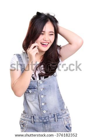Portrait of joyful Asian girl talking on mobile phone expressively, isolated on white background - stock photo