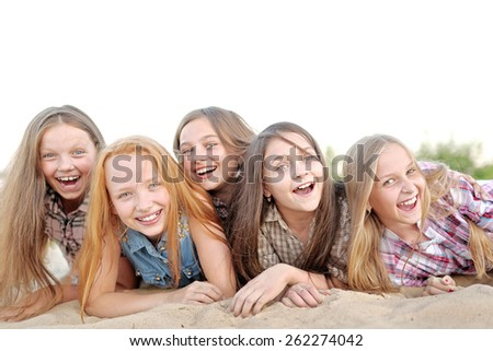 Portrait of joyful beautiful girlfriends on the nature - stock photo