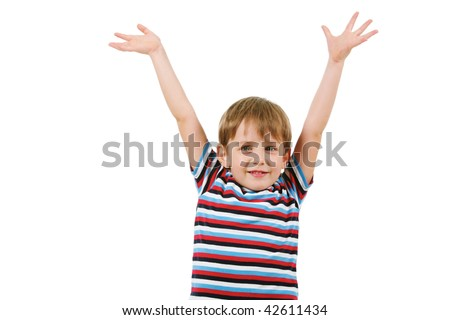 Portrait of joyful boy looking at camera with raised arms - stock photo