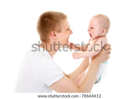 Portrait of joyful father playing fun with his baby - stock photo