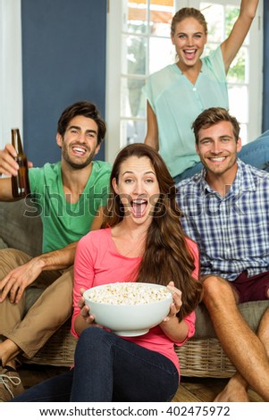 Portrait of joyful friends enjoying party at home