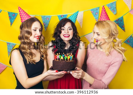 Portrait of joyful friends toasting and looking at camera at birthday party. Attractive friends celebrating a birthday. Smiling girls with glasses of  champagne  - stock photo