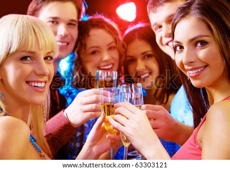 Portrait of joyful people celebrating birthday - stock photo