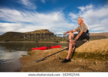 Portrait of Kayaker and Active Senior Man Taking a Restful Break.  - stock photo