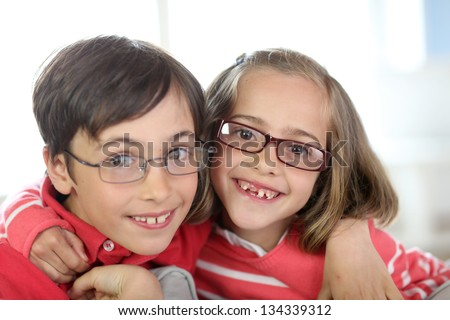 Portrait of kids wearing eyeglasses - stock photo
