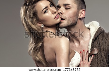 Portrait of kissing couple