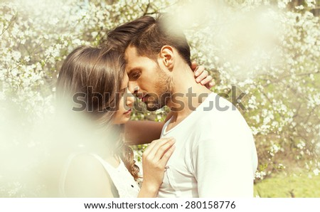 Portrait of kissing couple - stock photo