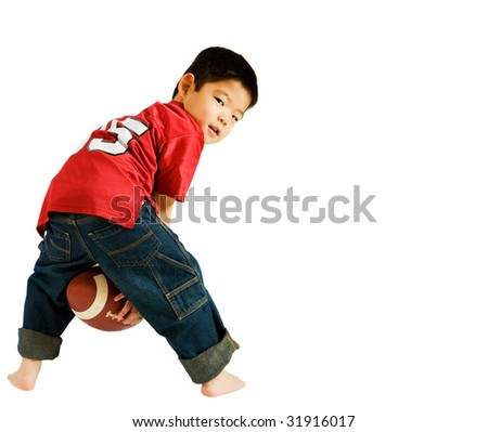 Portrait of Korean Boy, Back view, Holding football. - stock photo