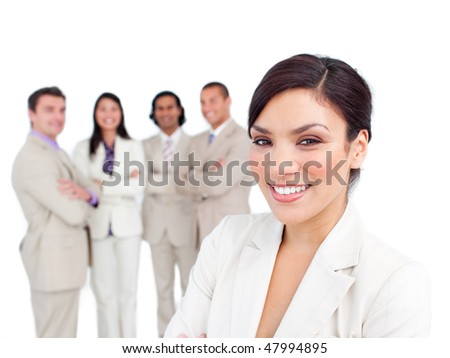 Portrait of latin businesswoman smiling with his team on the background