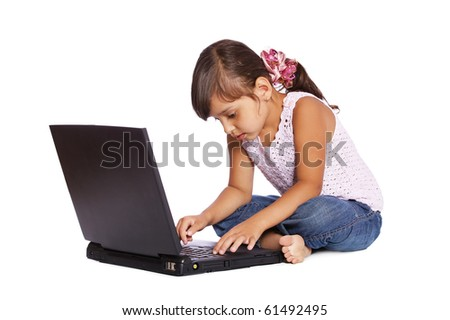 portrait of latin child girl on white with laptop