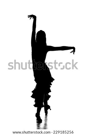 Portrait of latin female dancer in action, silhouette, isolated on grey. - stock photo
