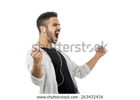 Portrait of latin man smiling and listen music  - stock photo