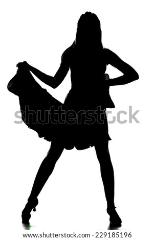 Portrait of latino female dancer in action, silhouette, is holding her dress. Isolated on grey. - stock photo