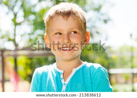 Portrait of laughing and smiling little boy - stock photo