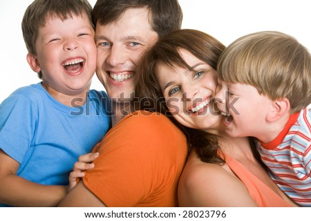 Portrait of laughing family members having a good time together - stock photo