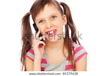 portrait of  laughing little girl with cellphone. isolated on white background - stock photo