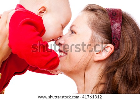Portrait of laughing mother and baby in red - stock photo
