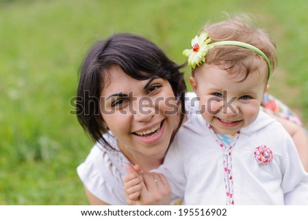 portrait of laughing pretty woman and her daughter - stock photo