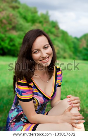 PORTRAIT OF LAUGHING YOUNG WOMAN OUTDOOR